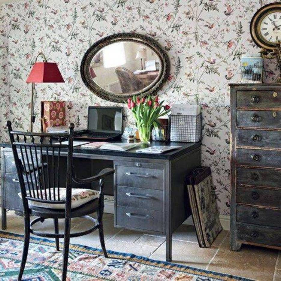 home-office-cottage-style-with-floral-wallpaper-and-mirror-and-vintage-furniture-and-tavertine-floor-and-rug-and-floor-lamp-with-red-shade